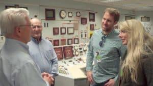 Entrepreneurs speak to veterans in EBR-II control room. From left to right: Peter Planchon, John Sackett, Jacob DeWitte and Caroline Cochrane Photo credit: David Schumacher