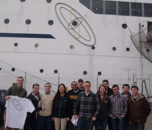 SUNY Senior Designers Outside NS Savannah Under Atomic Logo